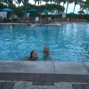 Swimming at the hotel pool.