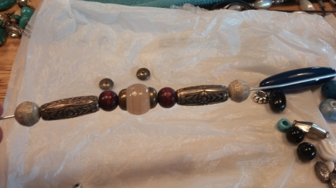 another one for a middle part, still need some different wooden beads for each side