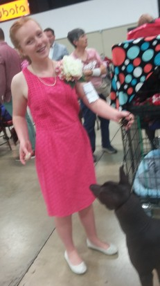 pink dress with giant broach at the west palm beach show