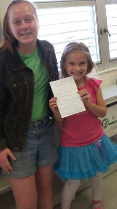 This cutie takes some classes I take with homeschool, and she brought her poem with her to show me again